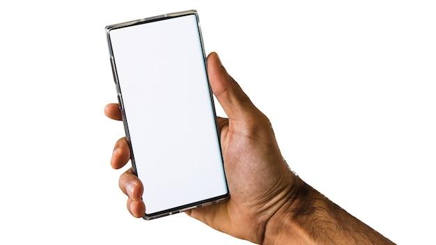 Tenendo il telefono cellulare o tablet isolato su sfondo bianco. mano maschio che tiene elettronica, spazio per il testo.