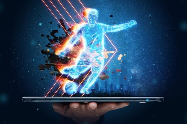 Un ologramma di un giocatore di football che esce dallo schermo di uno smartphone. il concetto di scommesse sportive, calcio, gioco d'azzardo, trasmissione online del calcio.