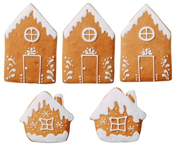 Biscotti a forma di hom con un motivo isolato set di fiocchi di neve di biscotti allo zenzero su uno sfondo bianco