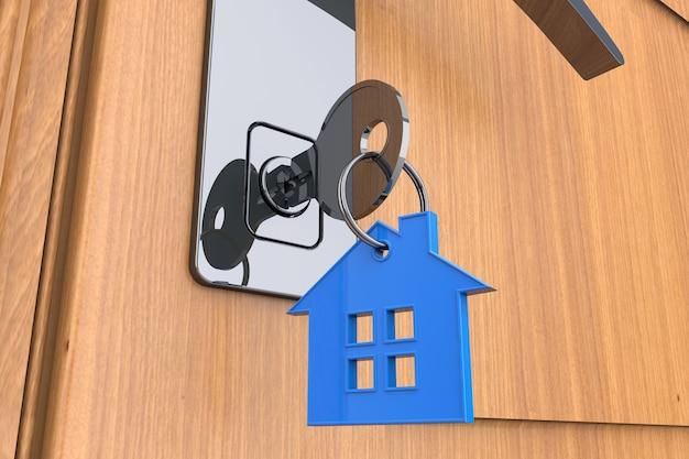 Chiave di casa con il simbolo del portachiavi della casa con una porta di legno