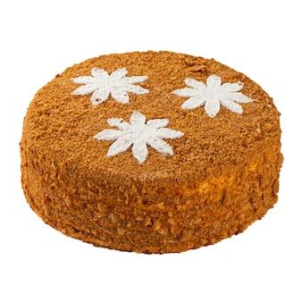 Torta di miele con crema isolata su bianco