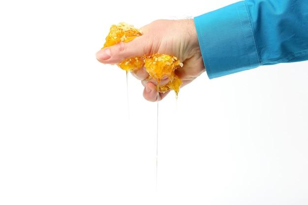 Miele dalle mani che gocciolano