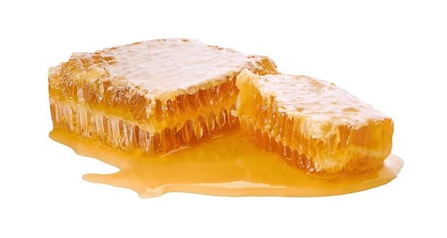 Miele isolato su una superficie bianca
