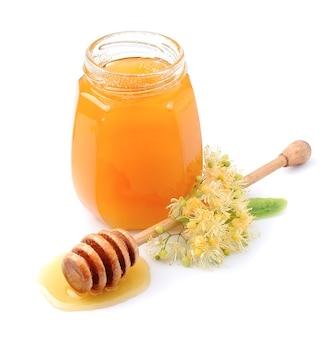 Miele con fiori di tiglio isolati