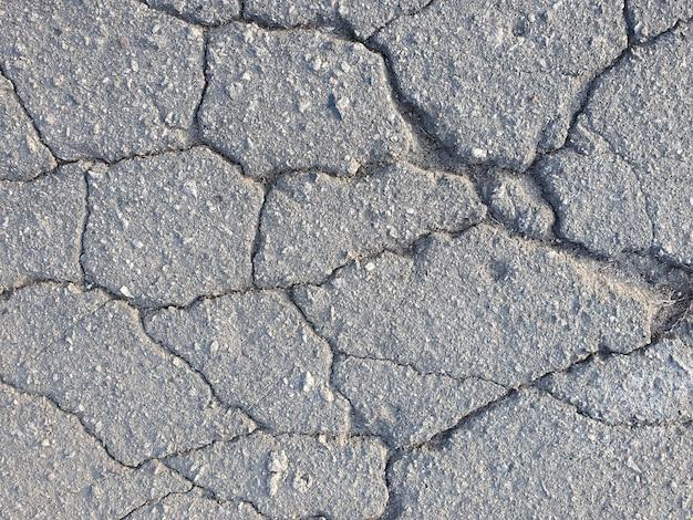 Sfondo di asfalto orizzontale con crepe