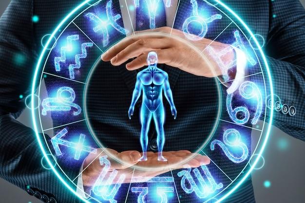 Concetto di oroscopo, uomo sullo sfondo di un cerchio con i segni dello zodiaco, astrologia. consultazione con le stelle.