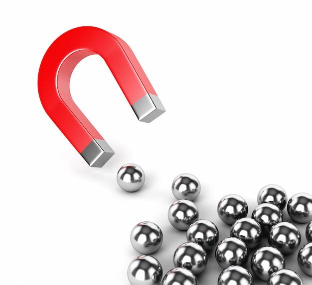 Magnete a ferro di cavallo e sfere metalliche