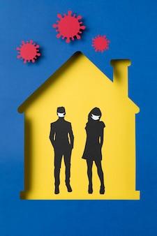 Casa con uomo e donna che indossa maschere mediche