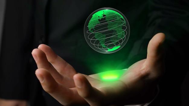 Mano umana che tiene la tecnologia olografica del globo terrestre