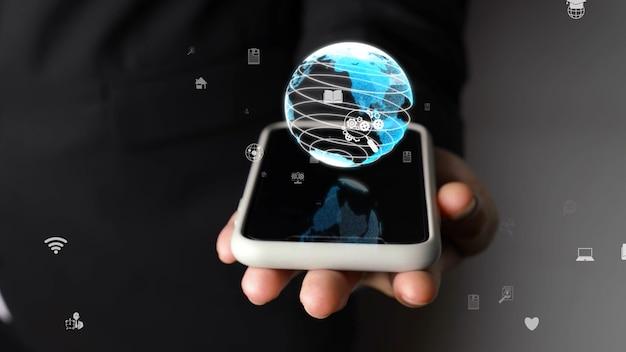 Mano umana che tiene il telefono cellulare con tecnologia olografica del globo terrestre