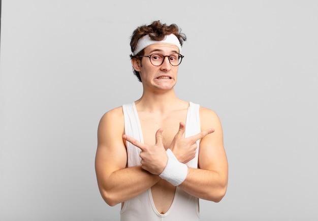 Uomo sportivo umoristico che sembra perplesso e confuso, insicuro e punta in direzioni opposte con dubbi
