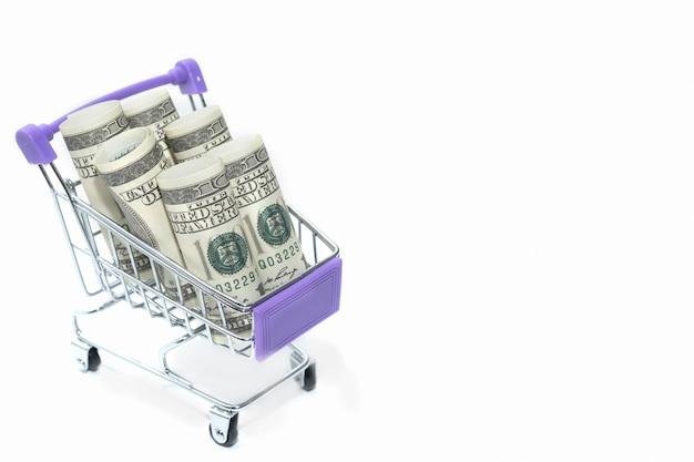 Banconote da cento dollari su un piccolo carrello