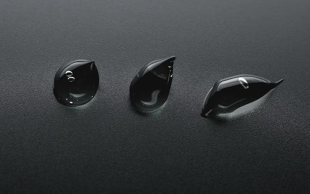 Gocce di acido ialuronico su sfondo nero