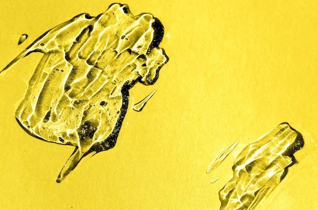 Gel di acido ialuronico nel colore trendy del giallo illuminante anno 2021. sfondo con texture con bolle di ossigeno