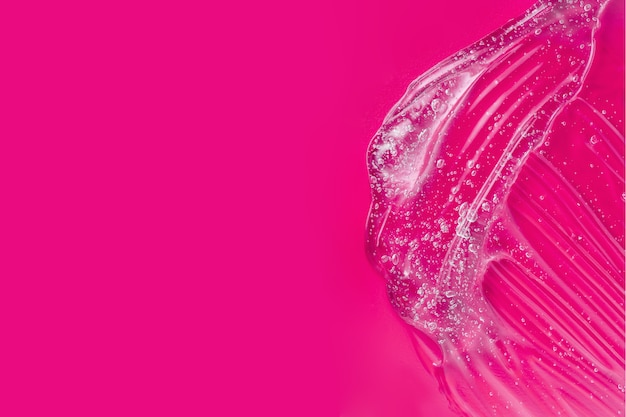 Striscio di acido ialuronico. campione di lubrificante. crema idratante con vitamina. consistenza gelatina. prodotto per la cura della pelle trasparente. gel cosmetico sfumato con bolle e aloe. spruzzata di lozione liquida. gel di siero. copia spazio