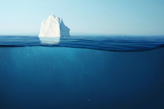 Iceberg galleggia nell'oceano con una vista subacquea. fusione dei ghiacciai e concetto di riscaldamento globale