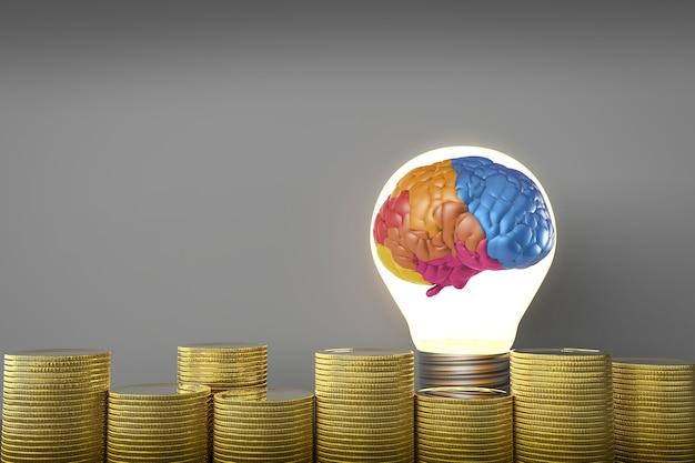 L'idea crea il concetto di denaro con cervello colorato in lampadina e monete d'oro