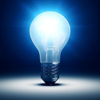 Lampadina illuminata su sfondo blu scuro