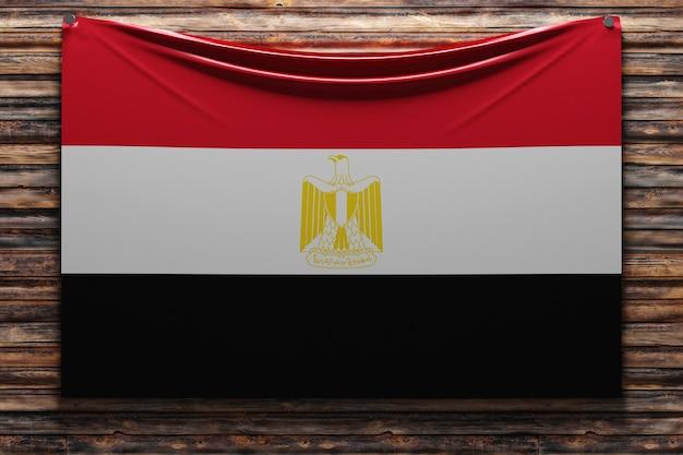 Illustrazione della bandiera nazionale del tessuto dell'egitto inchiodata su una parete di legno