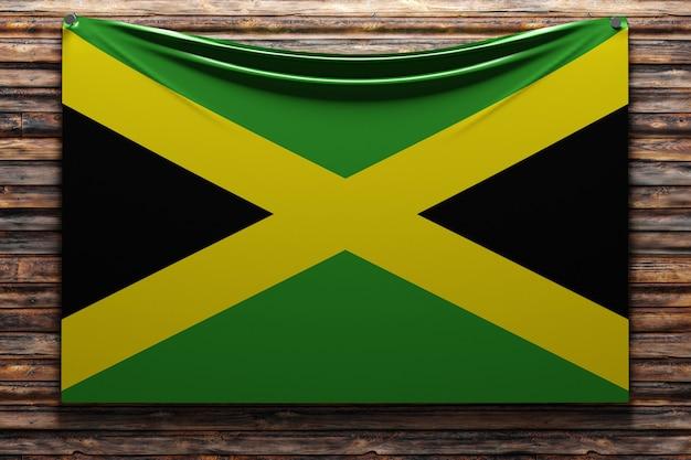Illustrazione della bandiera nazionale del tessuto della giamaica inchiodata su una parete di legno