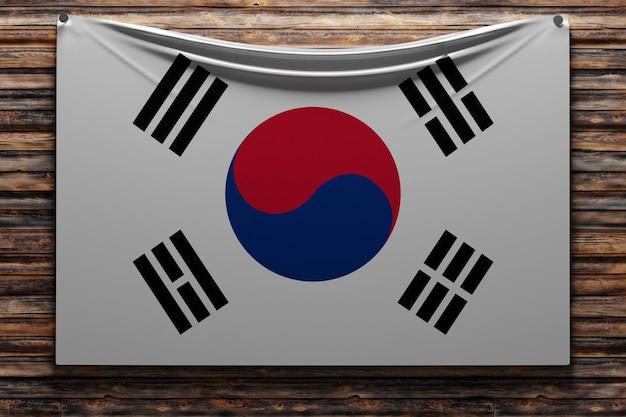 Illustrazione della bandiera nazionale del tessuto della corea del sud inchiodata su una parete di legno