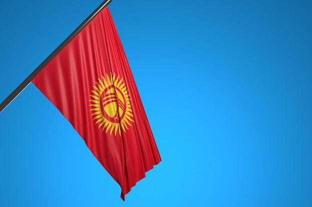 Illustrazione della bandiera nazionale del kirghizistan su un pennone di metallo che fluttua contro il cielo blu