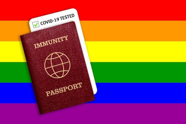 Passaporto di immunità e risultato del test per covid-19 sulla bandiera di lgbt. certificato per le persone che hanno avuto il coronavirus o fatto il vaccino.
