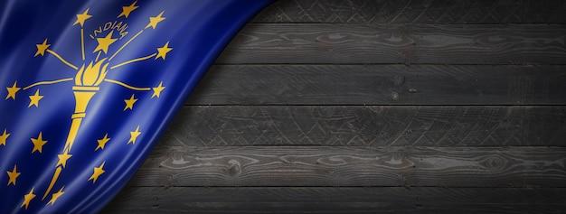 Bandiera dell'indiana sul banner di parete in legno nero, stati uniti d'america. illustrazione 3d