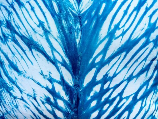 Tessuto blu indaco tie dye pattern di sfondo. trama del tessuto tinto indaco con motivo grafico astratto etnico.