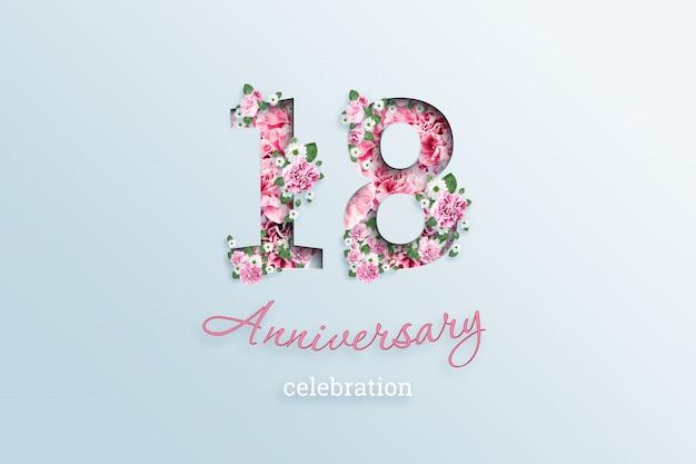 La scritta numero 18 e la celebrazione dell'anniversario textis fiori, su una luce