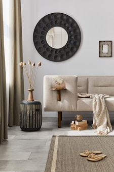 Interior design del soggiorno in stile etnico con comò moderno, specchio rotondo, decorazione, mobili e accessori personali. modello. muro bianco.