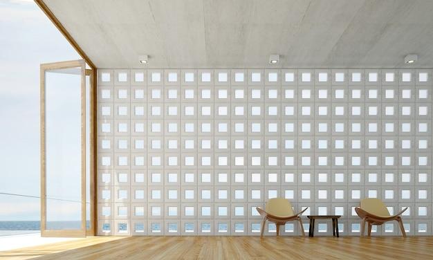 Il design degli interni del salotto e del soggiorno minimale e lo sfondo del muro di cemento e la vista sul mare