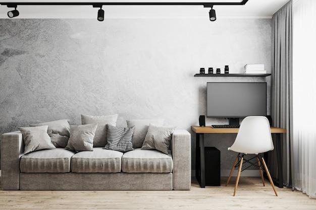 Interno di una stanza con divano grigio e tavolo con pc e sedia bianca