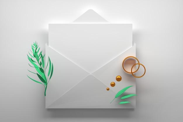 Carta in bianco della carta dell'invito con la busta bianca aperta e gli anelli dorati di fidanzamento