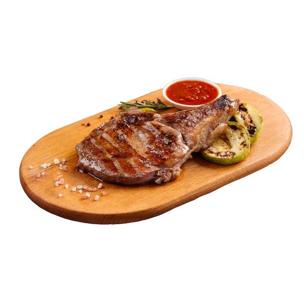 Porzione isolata di bistecca alla griglia con zucca