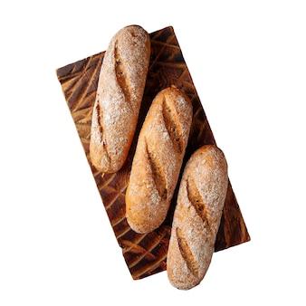 Isolato tre pagnotte di pane bianco su una tavola