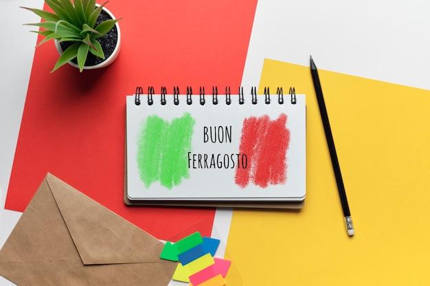 Italian holiday buon ferragosto disegnato su un taccuino.