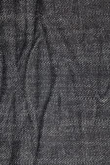 Fondo di struttura del primo piano dei jeans.