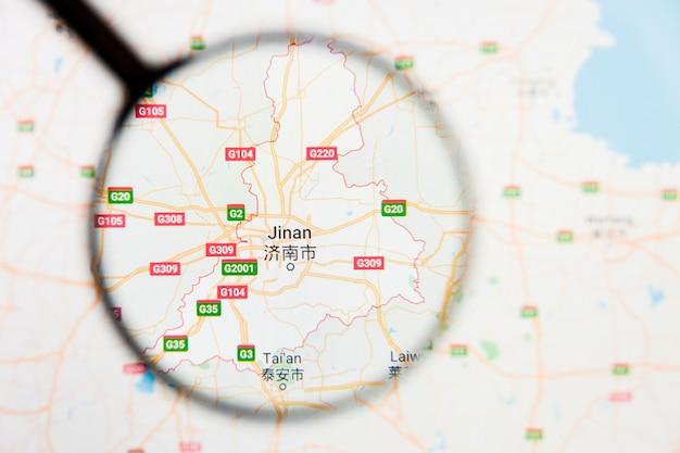 Jinan, concetto illustrativo di visualizzazione della città della cina sullo schermo tramite la lente d'ingrandimento