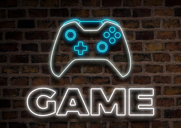 Joystick o gamepad, insegna al neon su uno sfondo di muro di mattoni. concetto di giochi per computer, torneo.