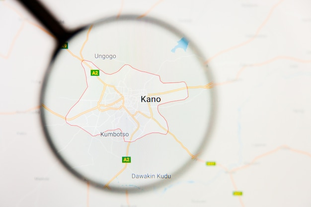 Concetto illustrativo di visualizzazione della città di kano, nigeria sullo schermo tramite la lente d'ingrandimento