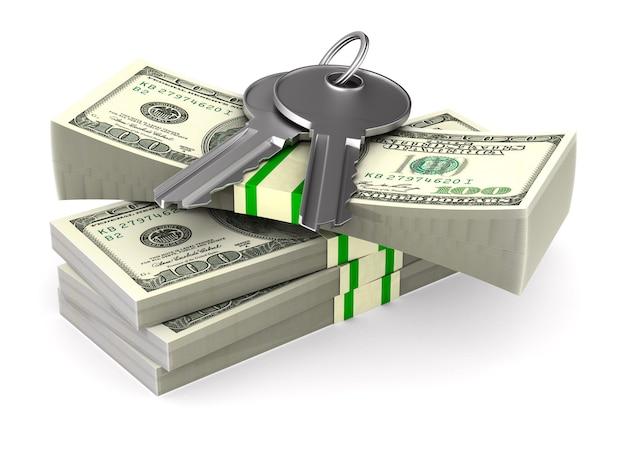 Chiavi e dollari su uno spazio bianco