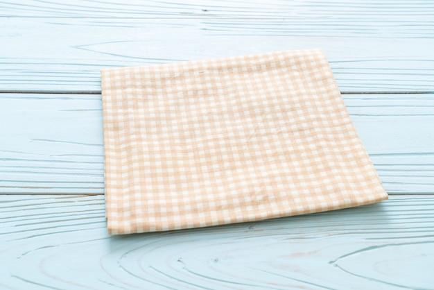 Panno della cucina su superficie di legno blu Foto Premium