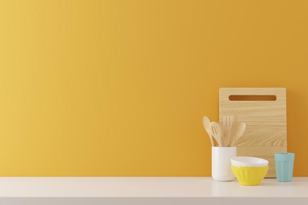 Il fondo degli utensili della cucina con lo spazio giallo della copia di struttura del muro di cemento per testo, 3d rende