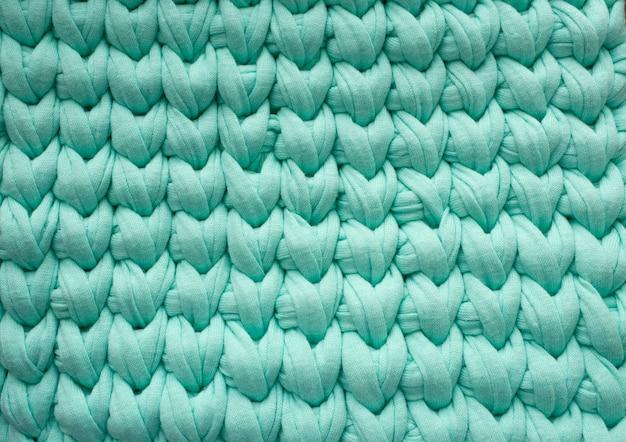 Sfondo a maglia. sfondo turchese.