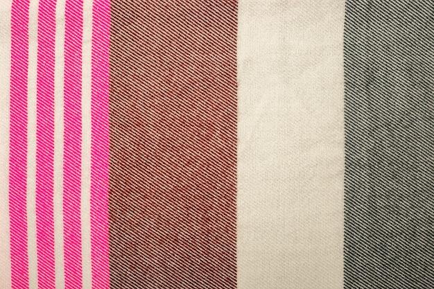 Trama del tessuto a maglia. sfondo caldo dettagliato fatto di filato. tessuto di lana naturale, frammento di un maglione per il design. banner. vista piana laico e dall'alto.