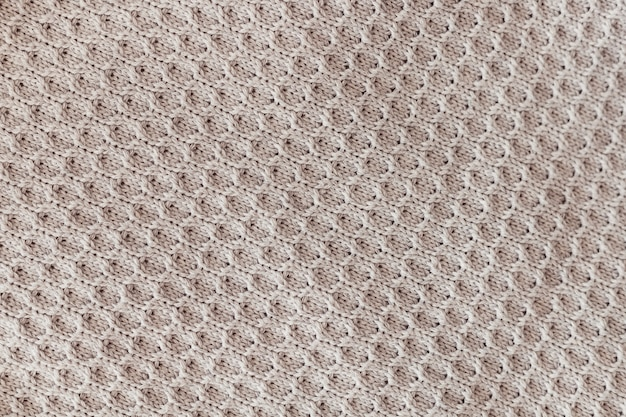 Trama di sfondo di lana grigia lavorata a maglia
