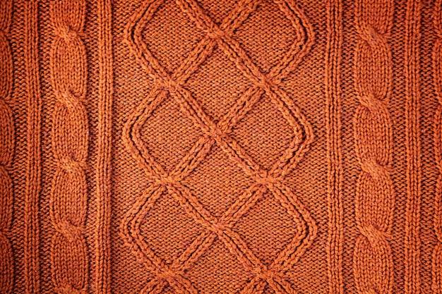 Trama di lana naturale arancione lavorata a maglia