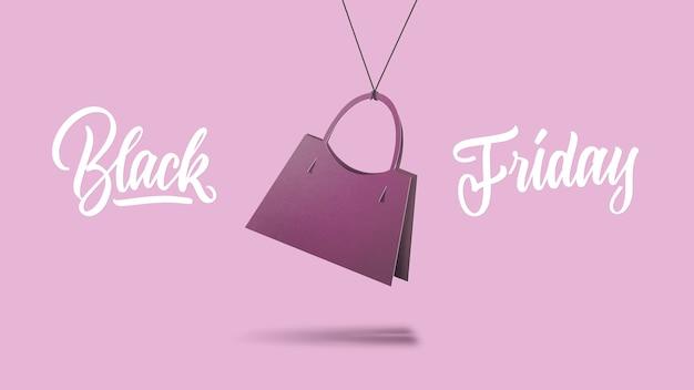 Un'etichetta a forma di borsa da donna classica in cartone su sfondo viola. il testo calligrafico è il venerdì nero. il concetto di vendita