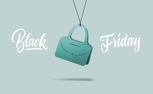 Un'etichetta a forma di borsetta da donna alla moda in cartone su sfondo viola. il testo calligrafico è il venerdì nero. il concetto di vendita